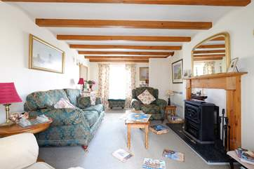 The sitting-room has a wood-burner effect electric stove.