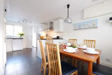 The kitchen/dining-room is cosy with under-floor heating.