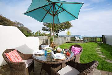 The lovely enclosed garden with views of Nare headland & Gull Rock.