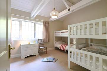 Bedroom 4 with two sets of bunk beds.