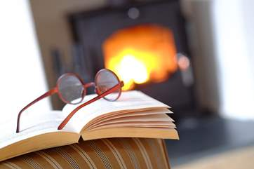 Snuggle up in front of the wood-burner with a good book.