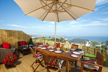 Dine al fresco with lovely views of the sea.