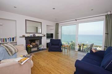 The living-room offers lovely sea views through the large double doors.