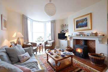 The sitting/dining-room has a cosy wood-burner.