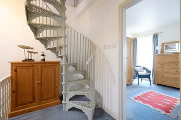 The spiral staircase leads up to Bedroom 4.