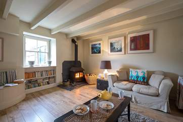 The sitting-room has a lovely wood-burner.