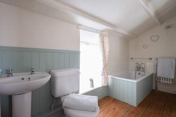 The bathroom with three-quarter size bath and walk-in shower.