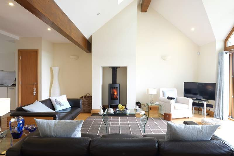 Relax in front of the cosy wood-burner.