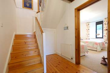 Stairs leading up to the open plan living space.