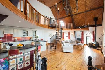 The open plan living-room with kitchen and dining areas.
