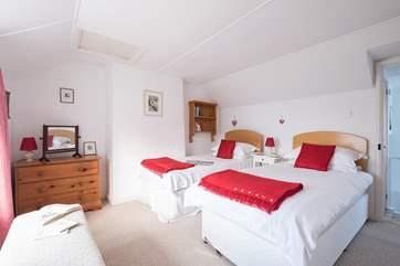Bedroom 1 has twin beds.