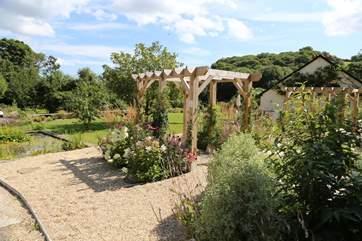 The front garden has a pergola.