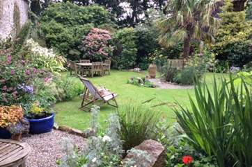 Relax in this gorgeous enclosed garden.