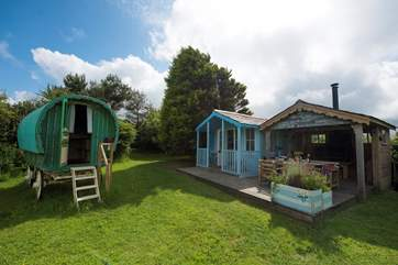 The cabin houses the kitchen, indoor dining-area and en suite shower-room and the summer-house has a wood-burner and undercover outdoor dining space.