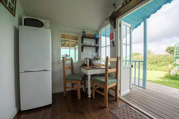 The cabin has a fully fitted kitchen-area and a little dining-area positioned to enjoy the views.