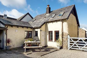 Welcome to Bluebell Cottage - the pretty enclosed courtyard is a lovely place to sit and relax