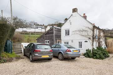 There is space for two cars (one large and one small) beside the cottage, the large area in the foreground is owned by the neighbour and is for turning purposes only for guests of Dairy Cottage.