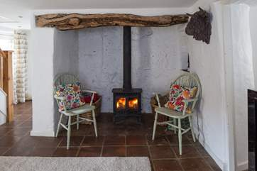 The cosy wood-burner sits within this magnificent fireplace, plus there is a bread oven towards the back.