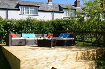 The raised decking area at the top of the garden is south facing, a great place for a morning coffee or evening glass of wine.