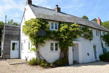 Dairy Cottage is semi-detached with space for two cars beside the cottage. The enclosed garden is up behind the cottage.