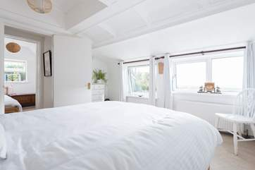 This lovely bedroom 2 also has windows with sea views so the room is flooded with light.