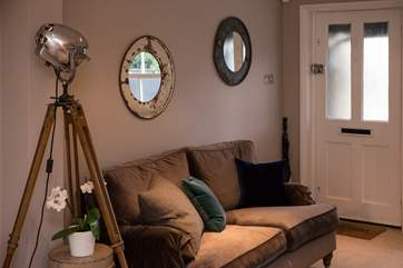 The luxurious sitting-room has some beautiful vintage features and a BOSE sound system.
