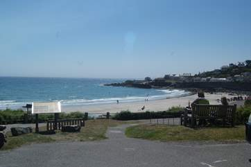 The large crescent shaped beach is sandy at low tide with room for relaxing with a picnic, sand castle building or a ball game or two.