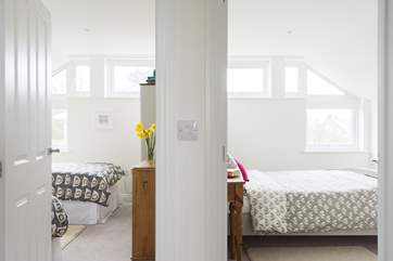 The bedrooms are next to eachother with the shower room on the left.