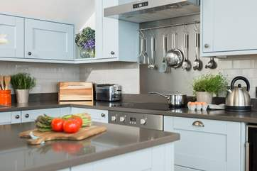 The stylish and very well-equipped kitchen even has a wine fridge.
