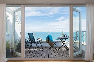 Open the doors up and bring the outside in, the balcony then becomes an extension of the living-room.