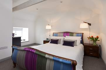 Laze in bed with views out over the surrounding countryside through the window