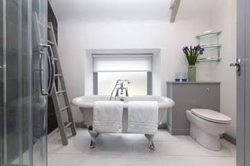 The family bathroom on the first floor with a deep double-ended bath as well as a shower cubicle. The hand held shower attachment has been removed.
