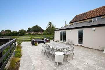 The huge terrace with room for al fresco dining, lounging and of course soaking in the hot tub with the view stretching out before you.