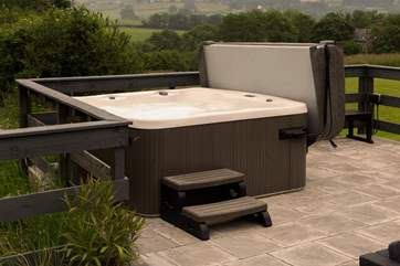 What a setting for the hot tub! You  can enjoy sitting under the stars or an early morning soak as the sun rises.