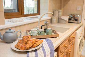 There is a compact galley-style kitchen - though very well-equipped for your holiday needs, there is even a Nespresso coffee machine.