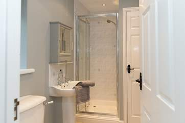 There is a spacious shower-room with a walk-in shower.