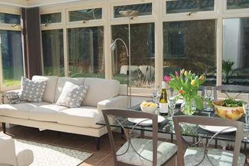 There is a gorgeously sunny conservatory/dining room looking out over the gardens and with French windows to the patio.