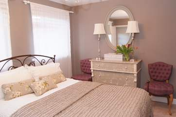This is one of the two double bedrooms - tranquil and stylish.