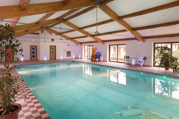 Guests at The Coach House and at The Cottage share full use of this amazing 13 metre indoor heated swimming pool. There is an outdoor tennis court too !