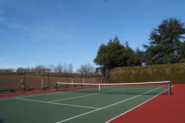 The tennis court is for you to enjoy too.  What a setting for a game ! Racquets and balls are provided.