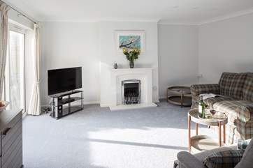 The spacious sitting room has a gas flame effect fire for cooler evenings.