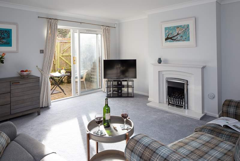 The comfy sitting room is the perfect place to relax after a busy day exploring.
