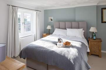 The master bedroom has a super-comfy 5ft bed and TV, perfect for breakfast in bed.