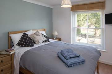 The double bedroom with a comfy 4ft 6 bed, looks out onto the high street.