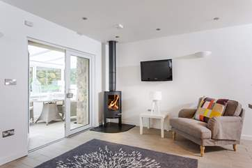 The gorgeous sitting-area has a roaring wood-burner.