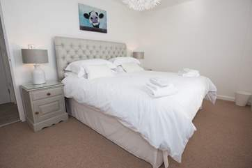 A 6' double bed with White Company linen.