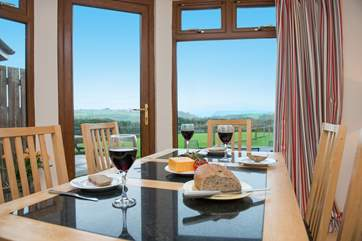 From the dining area you can look out across the garden and take in the far reaching views of the sea.
