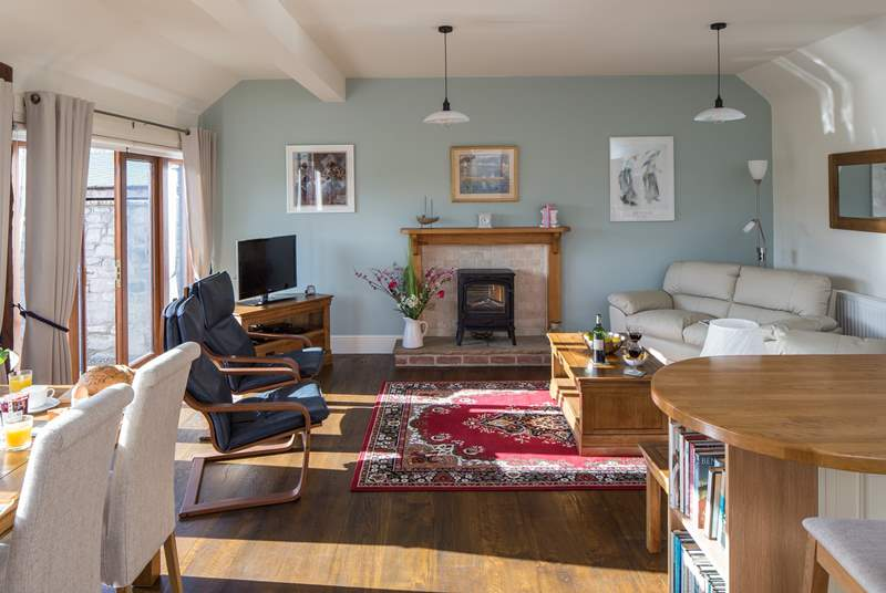 The open plan living-room is a bright and sociable space, the perfect place to relax.