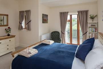 The master bedroom has a high quality 5ft bed and looks out onto the garden.
