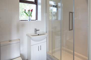The en suite shower-room has a large shower with a small step up into it.